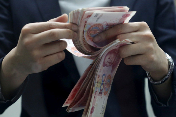 Morgan Stanley predicts China's yuan ranked third in the world after 10 years - Photo 1.