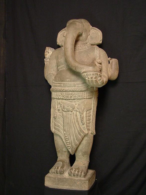 Hai cổ vật điêu khắc Chăm được công nhận bảo vật quốc gia - Ảnh 1.