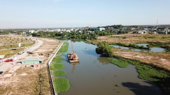 Xây Cầu Đò bắc ngang sông Thị Tính, tỉnh Bình Dương trị giá 213 tỉ đồng - Ảnh 1.