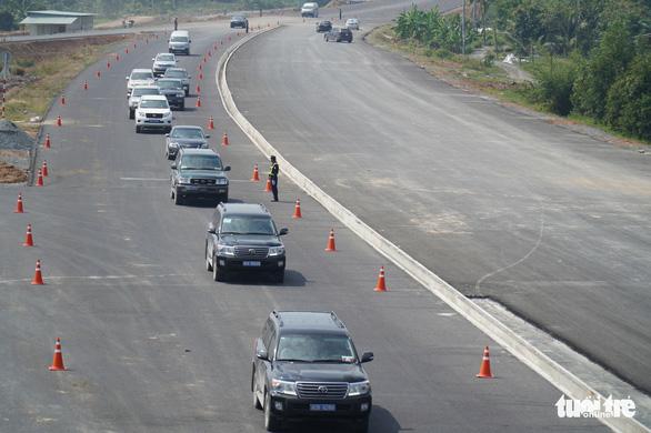Chỉ cho xe chạy đường cao tốc Trung Lương - Mỹ Thuận khi quốc lộ 1 ùn tắc - Ảnh 1.