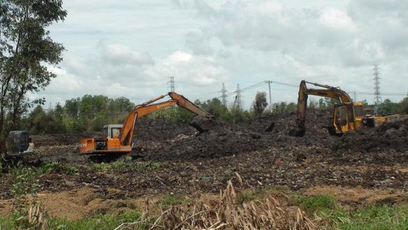 Hai công ty xử lý rác lớn tại TP.HCM chậm khắc phục ô nhiễm - Ảnh 1.