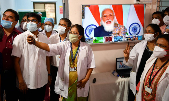هند بزرگترین کمپین واکسیناسیون جهان علیه COVID-19 را آغاز می کند - عکس 1.