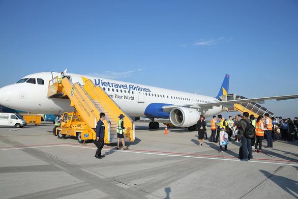 Hàng không tăng thêm máy bay, mở đường bay mới phục vụ tết - Ảnh 1.