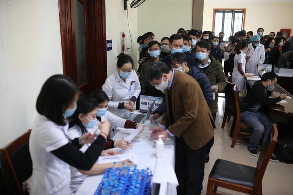 Xét nghiệm COVID-19 cho gần 500 phóng viên tác nghiệp tại Đại hội Đảng - Ảnh 1.