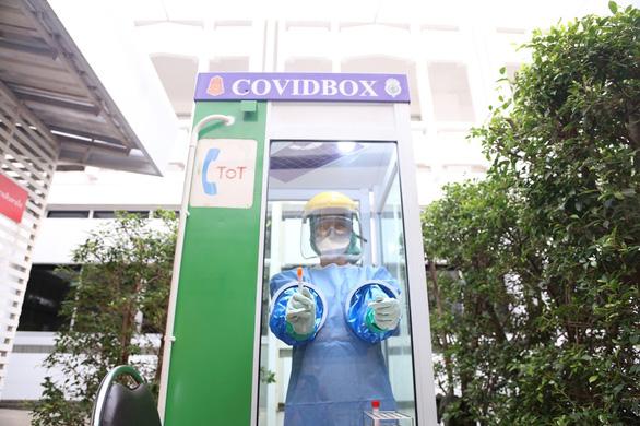 Bốt điện thoại thành điểm xét nghiệm COVID-19 - Ảnh 1.