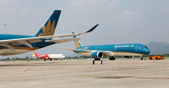 Cao điểm Tết Tân Sửu khai thác đến 1.200 chuyến bay nội địa mỗi ngày - Ảnh 1.