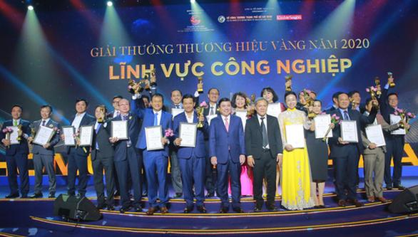 30 doanh nghiệp ở TP.HCM nhận danh hiệu Thương hiệu Vàng - Ảnh 1.