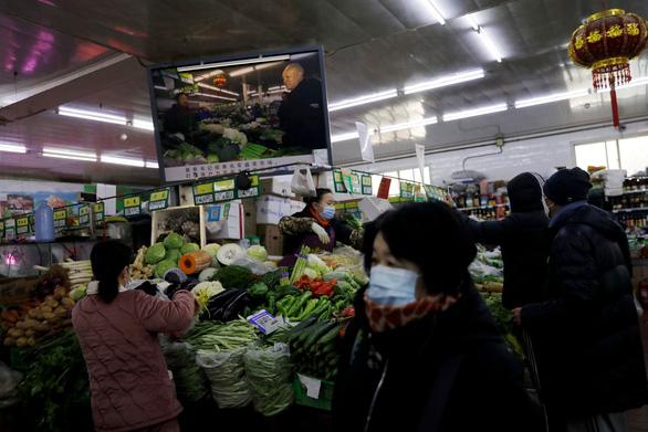 قیمت سبزیجات و گوشت در پکن با افزایش آماده سازی چینی ها برای استقبال از Tet خارج از خانه افزایش یافته است - عکس 1.