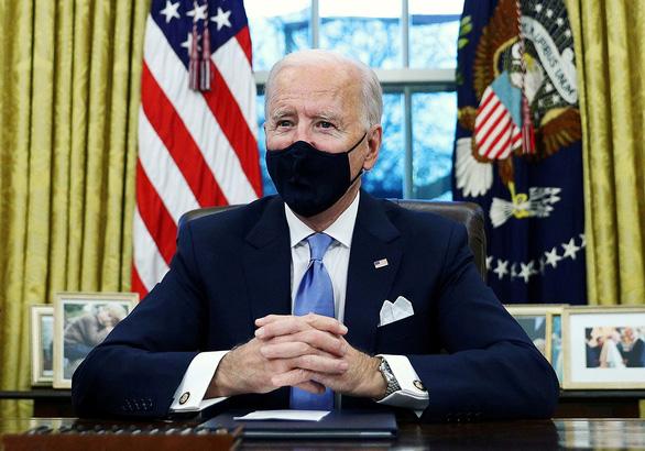 Ông Biden đảo ngược một loạt di sản ông Trump - Ảnh 1.