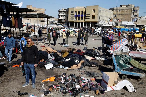 IS nhận trách nhiệm 2 vụ đánh bom ở Baghdad làm 32 người chết - Ảnh 1.