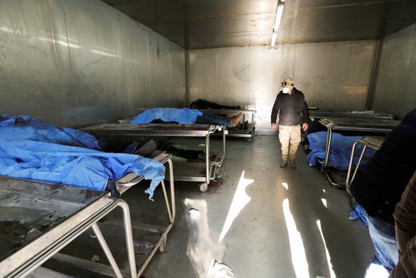 IS nhận trách nhiệm 2 vụ đánh bom ở Baghdad làm 32 người chết - Ảnh 2.