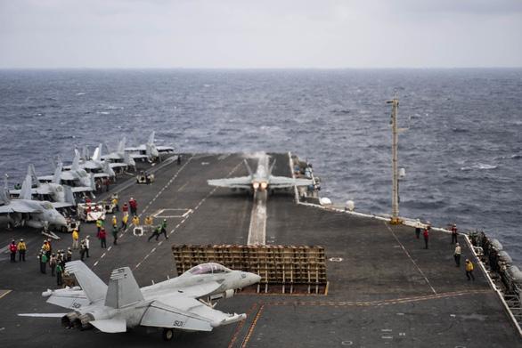 Tàu sân bay Mỹ lần đầu tới Biển Đông dưới thời Tổng thống Biden - Ảnh 1.