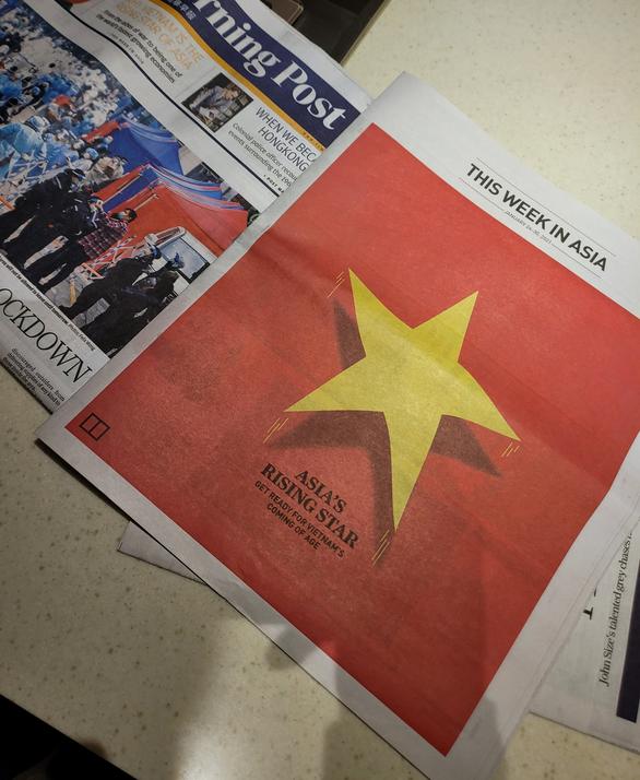 Báo Hong Kong in nguyên trang quốc kỳ Việt Nam, dành 6 trang viết về Đại hội Đảng XIII - Ảnh 1.