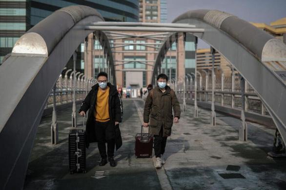 بسیاری از چینی ها به دلیل ترجمه COVID-19 - وطن خود را برای تعطیلات Tet ترک می کنند - عکس 2.