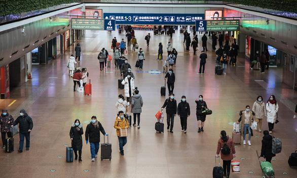 Hàng triệu người Trung Quốc bắt đầu Xuân vận giữa nỗi lo COVID - Ảnh 3.