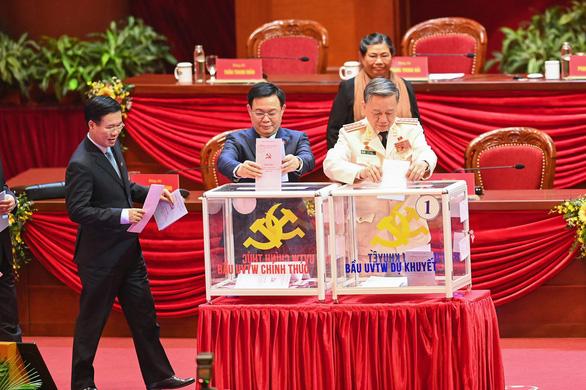 Hình ảnh các đại biểu Đại hội Đảng bỏ phiếu bầu Ban Chấp hành Trung ương khóa XIII - Ảnh 3.