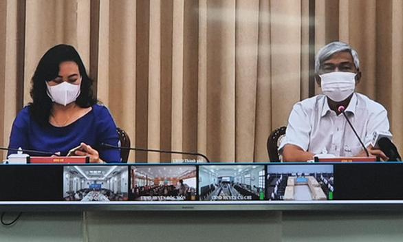 TP.HCM vẫn tổ chức các hoạt động tết theo 5K, Hà Nội xử nghiêm người không đeo khẩu trang - Ảnh 1.