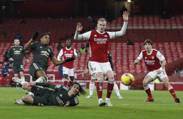 Cavani bỏ lỡ cơ hội không tưởng, Man United hòa Arsenal - Ảnh 1.