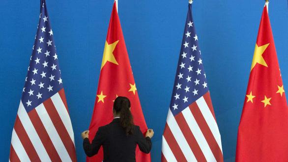 CNBC: Bắc Kinh sẽ không trả đũa việc Mỹ loại 3 công ty Trung Quốc khỏi sàn chứng khoán - Ảnh 1.