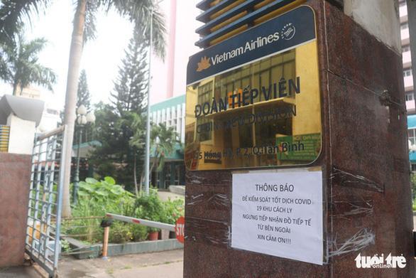 Khởi tố nam tiếp viên Vietnam Airlines làm lây lan dịch COVID-19 - Ảnh 1.