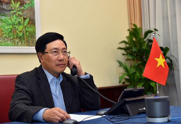 Việt Nam khẳng định hợp tác với Mỹ giải quyết vụ thao túng tiền tệ - Ảnh 1.