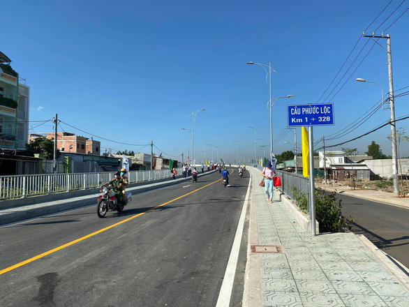 Chính thức thông xe cầu Phước Lộc sau 8 năm chờ đợi - Ảnh 2.