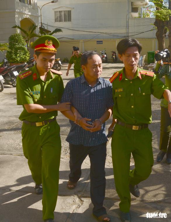 Bắt giam nguyên lãnh đạo chi nhánh Văn phòng đăng ký đất đai Phan Thiết - Ảnh 1.