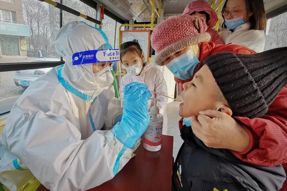 Úc nói Trung Quốc đừng trì hoãn đón tiếp các chuyên gia WHO tìm hiểu nguồn gốc virus - Ảnh 1.