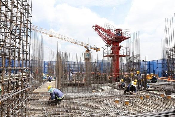 Kiểm toán Nhà nước phát hiện nhiều sai phạm trong cấp phép xây dựng tại TP.HCM - Ảnh 1.