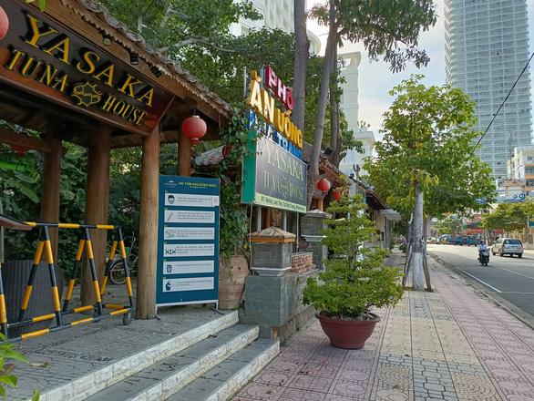 Nha Trang mở cửa Tháp Bà, Hòn Chồng, nhà hàng, khách sạn vẫn chưa dám mở - Ảnh 4.