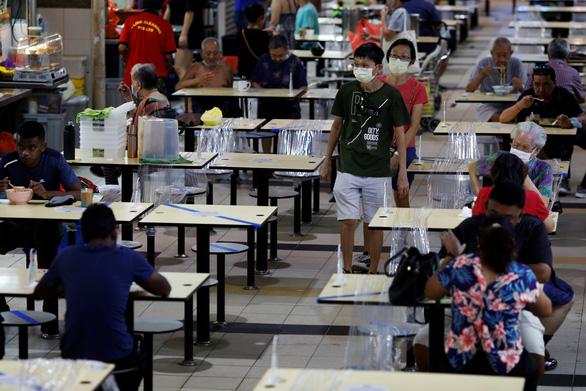 Singapore thận trọng nhưng không sợ virus - Ảnh 1.