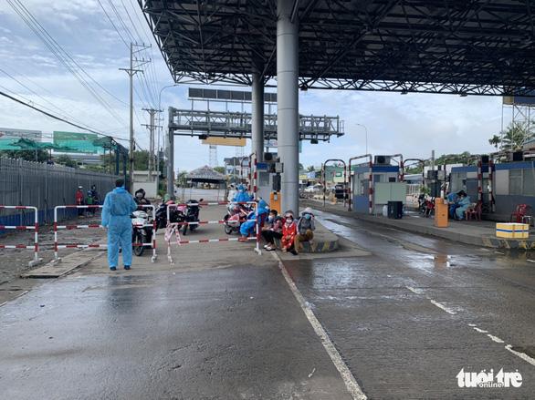 Trạm T2 vào An Giang bỏ test nhanh đối với tài xế đã tiêm vắc xin và có giấy âm tính - Ảnh 1.