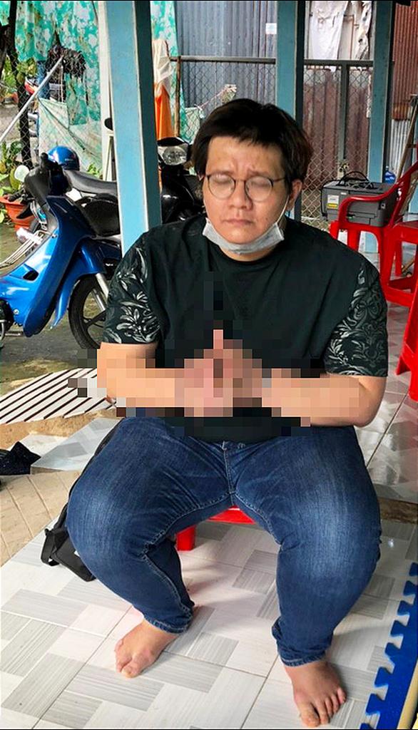 Bộ Công an bắt, khám xét nhà lập trình viên Nhâm Hoàng Khang - Ảnh 1.