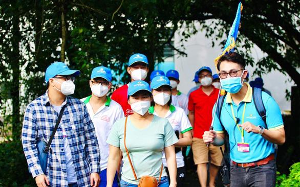 Saigontourist tặng bảo hiểm COVID cho du khách - Ảnh 1.