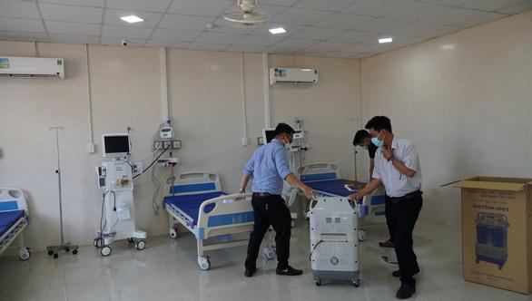 Bệnh viện dã chiến điều trị COVID-19 Gia Lai đón 8 bệnh nhân đầu tiên - Ảnh 1.
