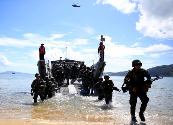 Philippines giải thích: Chỉ đòi công bằng chứ không tống tiền Mỹ - Ảnh 1.