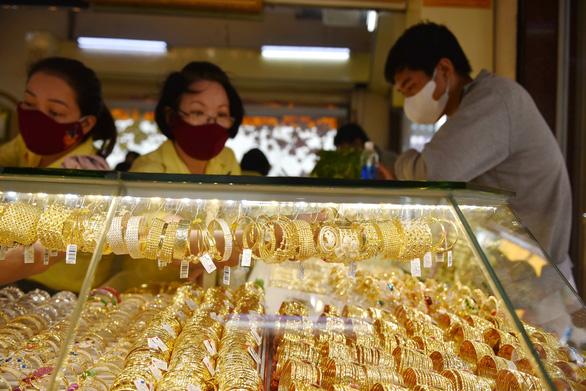 Giá vàng nhẫn tăng 230.000 đồng, lên mức 52,73 triệu đồng/lượng - Ảnh 1.