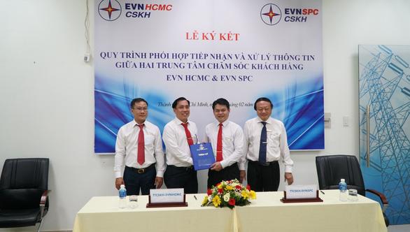 EVN SPC và EVN HCMC ký hợp tác cùng chăm sóc khách hàng sử dụng điện - Ảnh 1.