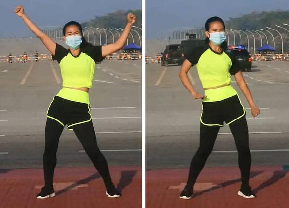 Cô gái thản nhiên tập thể dục giữa chính biến ở Myanmar? - Ảnh 1.
