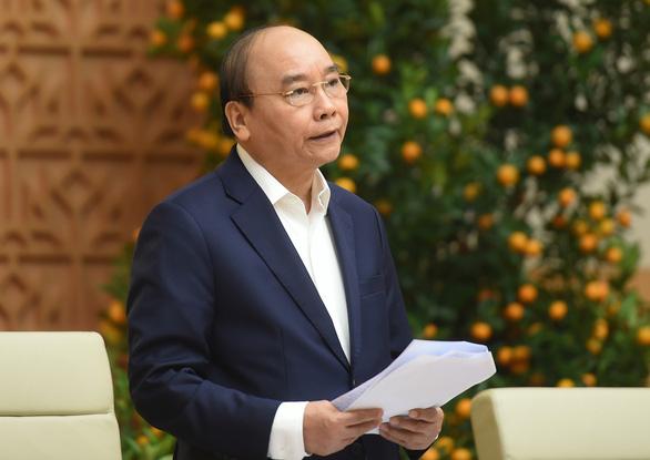 Thủ tướng Nguyễn Xuân Phúc: Sớm tiêm vắc xin trong quý I, tiêm chủng diện rộng - Ảnh 1.
