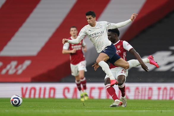 Hạ Arsenal, Man City thắng trận thứ 18 liên tiếp - Ảnh 2.