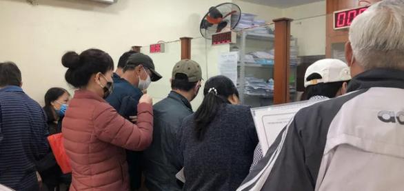 Cục Thuế Hà Nội làm cả 2 ngày cuối tuần để xử lý hồ sơ nộp tiền sử dụng đất - Ảnh 1.