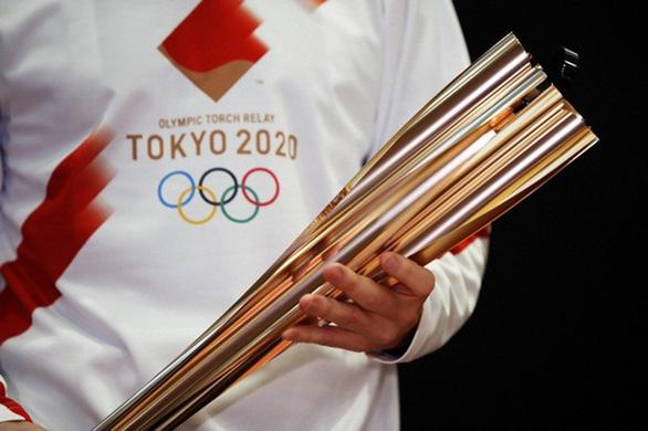 Rước đuốc Olympic Tokyo thời bình thường mới - Ảnh 1.