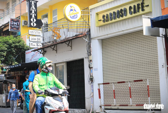TP.HCM phong tỏa quán cà phê đường Bùi Viện liên quan công chứng viên mắc COVID-19 - Ảnh 1.