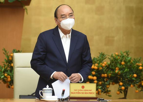 Thủ tướng đồng ý cho TP.HCM, Hà Nội có thể giãn cách xã hội - Ảnh 1.