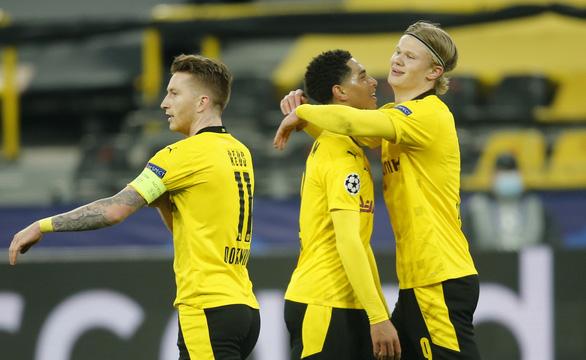 Haaland lại tỏa sáng, Dortmund loại Sevilla vào tứ kết Champions League - Ảnh 1.