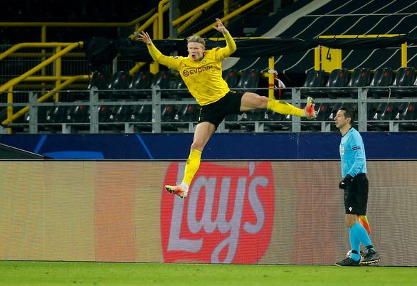 Haaland lại tỏa sáng, Dortmund loại Sevilla vào tứ kết Champions League - Ảnh 2.