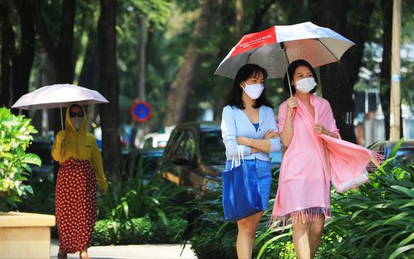 Người dân TP.HCM có thể chịu cái nóng tới 39 độ C - Ảnh 1.