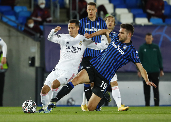 Real Madrid tiến vào tứ kết Champions League sau hai mùa bị loại - Ảnh 2.