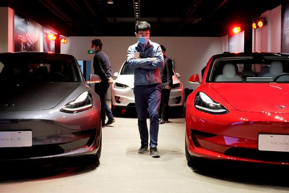 Trung Quốc cấm xe Tesla trong các khu quân sự - Ảnh 1.
